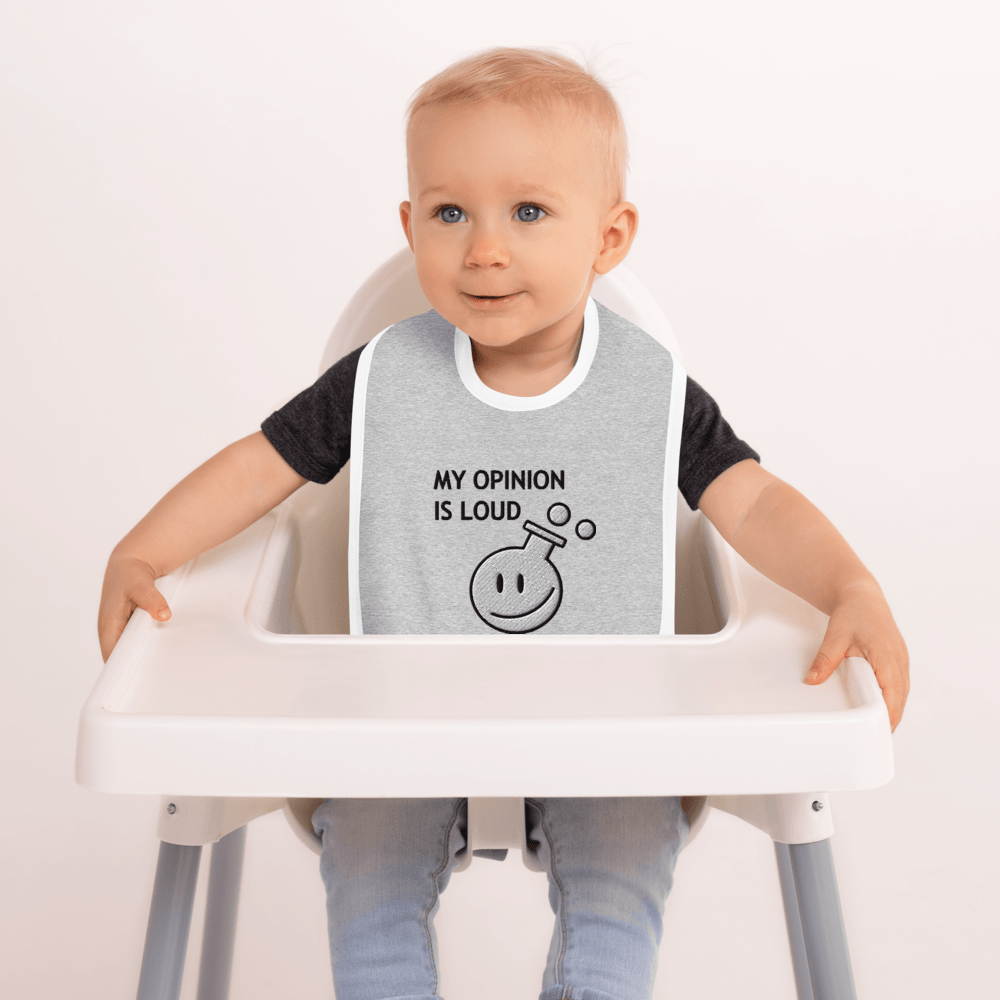 photo of a child wearing a Bib for children with a loud opinion